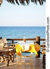 Outdoor restaurant table in Greece