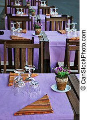 Outdoor restaurant - Violet and orange table setting in ...