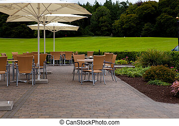 Outdoor Restaurant with Golf Course in the Background