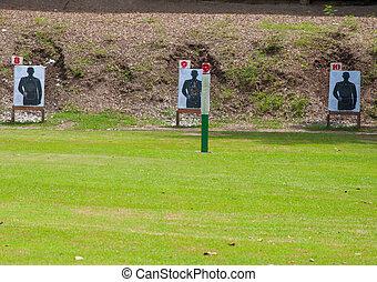 Outdoor shooting target in lawn.