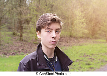 outdoor shot of a teenage boy