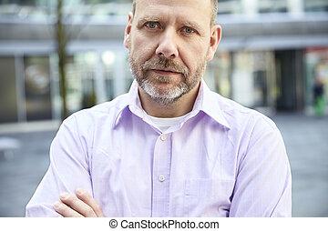 Outdoor shot of pensive man - Outdoor shot of pensive mature...