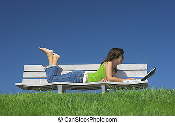 Outdoor study - Woman in outdoor study with a laptop