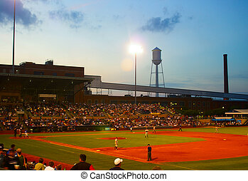 outdoor summer baseball game at dusk