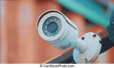 outdoor surveillance camera hanging outside. security camera...