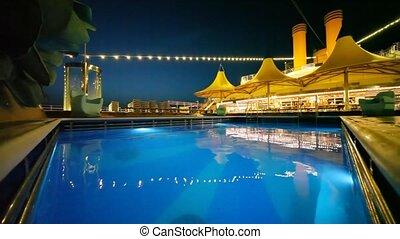 outdoor swimming pool in night cruise ship