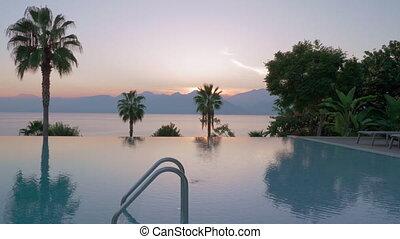 Outdoor swimming pool on resort near the sea, scene at...
