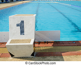 Outdoor swimming start platform with no one in sunny day.