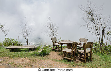 Outdoor table and chairs in foggy morning