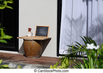 Outdoor table on wood terrace with white curtain background