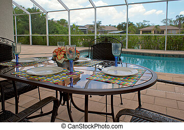 outdoor table setting for four - a table is set for dinner...