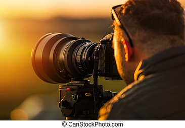 Outdoor Telephoto Photography. Caucasian Photographer in His...