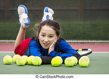 Outdoor Tennis Fun for Girl - Horizontal portrait of smiling...