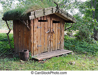 Outdoor toilet of wood - Image of an outhouse or outdoor...