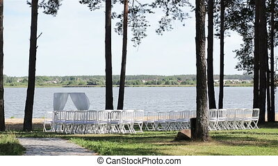 Outdoor wedding decoration row of chairs