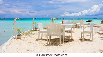 Outdoor white cafe on tropical beach