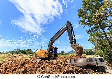 Excavator digging to moving the soil to the truck and adjusting ground level in construction site.