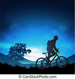 Outdoors Adventure - A moutain biker heading for the hills....