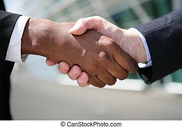 Outdoors business handshake