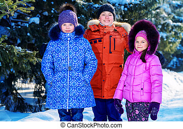 outerwear for winter - Happy children playing together...