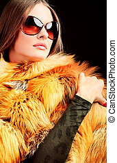 outerwear - Portrait of a beautiful young woman in a fur.