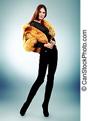 outerwear - Portrait of a beautiful young woman in a fur...