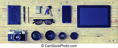 Outfit of a stylish traveler or a freelance journalist. Set of different objects and equipment.