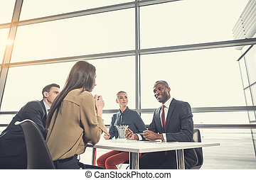 Outgoing employers communicating at work