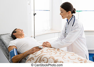 Outgoing female doctor caring about patient