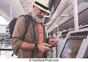 Outgoing happy pensioner typing in phone