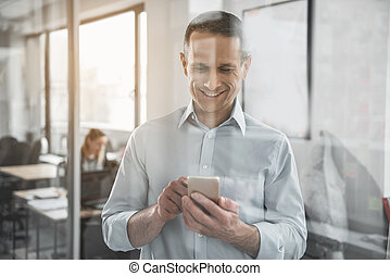 Outgoing male sending message in phone