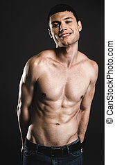 b39baae9e Keeping his body in good shape. cheerful young muscular man looking ...