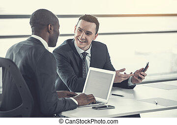 Outgoing man talking with business partner