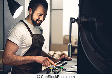 Outgoing man working on digital device