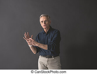 Outgoing old man gesticulating hands