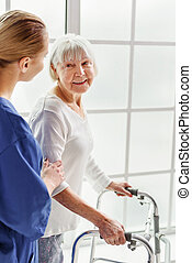 Outgoing pensioner telling with happy physician in clinic