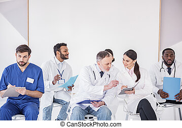 Outgoing physicians arranging lectures in clinic