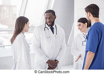 Outgoing physicians telling in hospital
