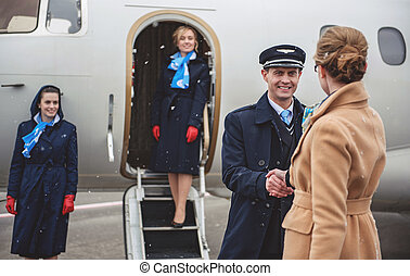 Outgoing pilot greeting with female