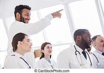 Outgoing therapeutics looking at lecture in clinic