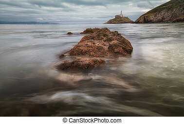 Outgoing tide at Mumbles lighthouse