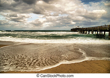 Waves and wind at the Lake Worth Pier in Florida