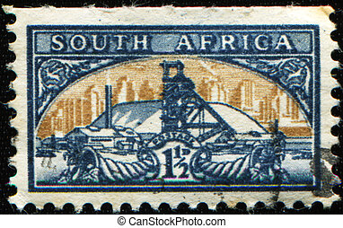 Gold Mine Bilingual pair - OUTH AFRICA - CIRCA 1941: A stamp...