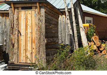 Outhouse Business - Rustic log sided, outhouse sits for sale...