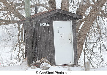 Outhouse by Lake - Solid wooden outhouse on rise by a ferry...
