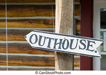Outhouse sign in front of roadhouse, Alaska