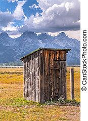 Outhouse in Mormon Row, with Teton Range in background