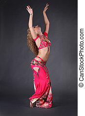 Outline body of dance woman in red on black background, Egyptian pose