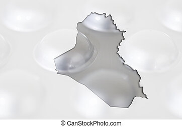 Outline iraq map with transparent background of capsules symbolizing pharmacy and medicine