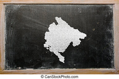 outline map of montenegro on blackboard - drawing of...